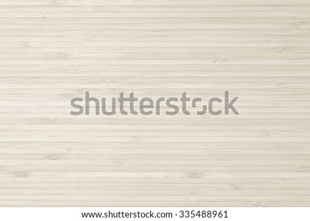 Bamboo wood texture background in natural light sepia beige cream brown color tone: Wooden cutting board detailed textured backdrop in antique tan brown toned colour   - stock photo