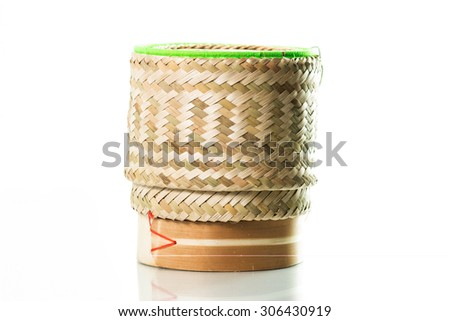 Bamboo wooden rice box for sticky rice on isolated white background in Thailand