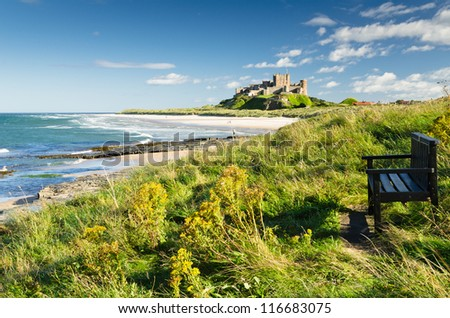 Bamburgh Castle and seat / Bamburgh Castle taken here from the north dates back to the 6/7th century - stock photo