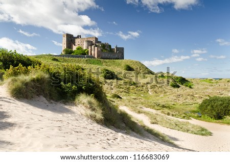 Bamburgh Castle from south / Bamburgh Castle taken here from the south dunes dates back to the 6/7th century - stock photo