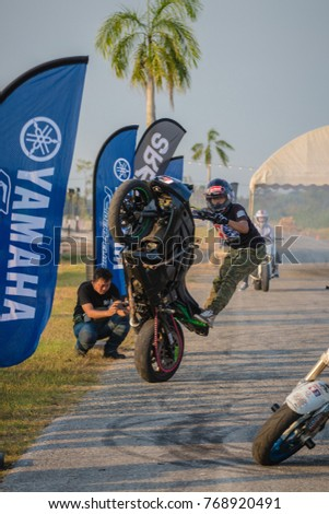 Ban Chang District RAYONG, THAILAND - November 18, 2017 : It is the show of motorcycle's Stuntman.