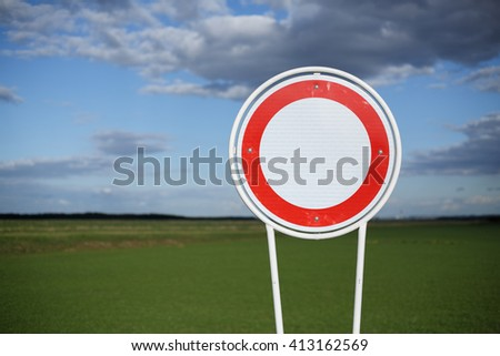 Ban of traffic sign, fields in background, shallow depth of field. - stock photo
