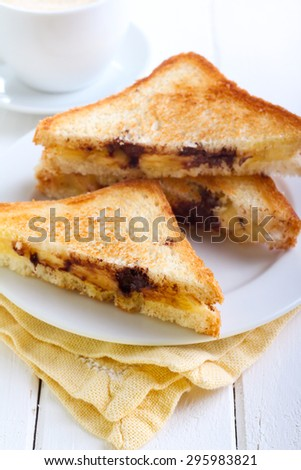 Banana and chocolate grilled sandwiches on plate