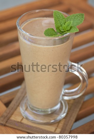 Banana and chocolate milk shake with fresh mint - stock photo