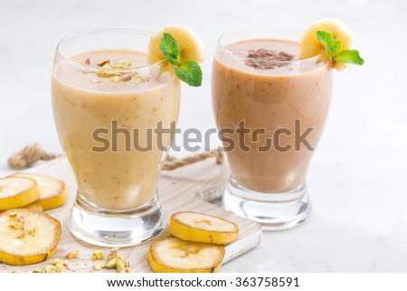 Banana and chocolate milkshake, closeup, horizontal - stock photo