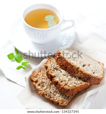 Banana bread and herbal tea - stock photo