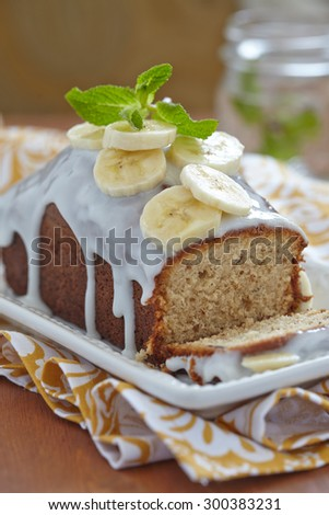 Banana bread with chocolate chips on wooden table - stock photo