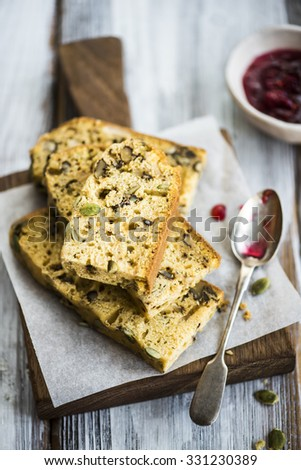 Banana bread with pumpkin on a wooden board - stock photo