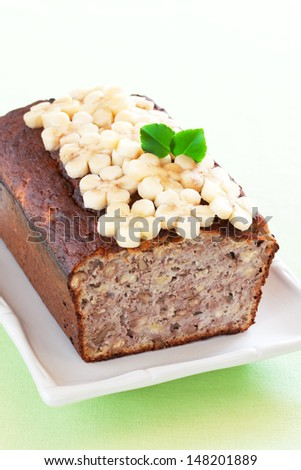 Banana bread with walnuts, selective focus - stock photo