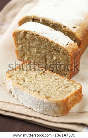 Banana Cake on a baking paper and beige kitchen towel. - stock photo