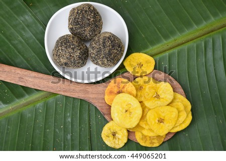 Banana chips, rice balls, popular traditional sweet and savoury  tea time snack of Kerala India made of flour, deep fried in coconut oil on Onam, Vishu, Ramadan festivals. crunchy South Indian food. - stock photo
