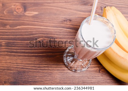banana chocolate cocktail behind bananas - stock photo