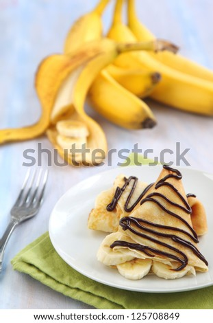 Banana Crepe with Chocolate syrup - stock photo