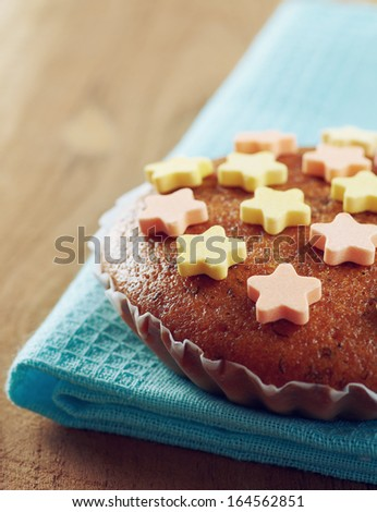 Banana cup cake on the vintage wood table - stock photo