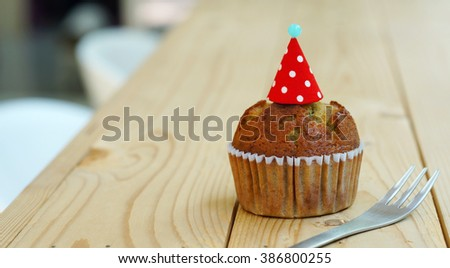 Banana cup cake on wooden table