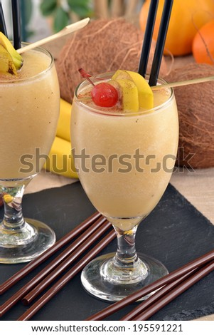 Banana daiquiri cocktail drinks and fruit. - stock photo