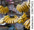 Banana hanging in asian market, closeup - stock photo