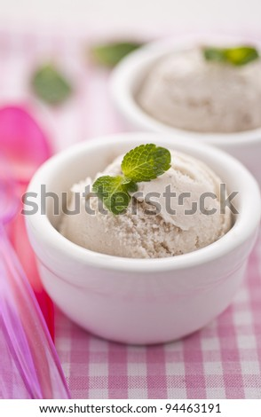 Banana ice cream over pink towel - stock photo