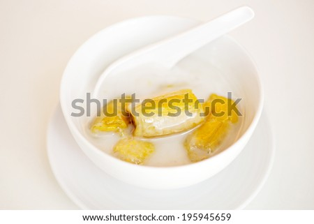 banana in coconut milk,Sweet yellow banana Topped with coconut milk is the famous dessert Thailand - stock photo