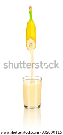banana juice pouring in glass isolated on white background - stock photo