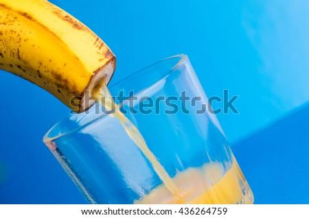 banana juice, pouring with banana - stock photo