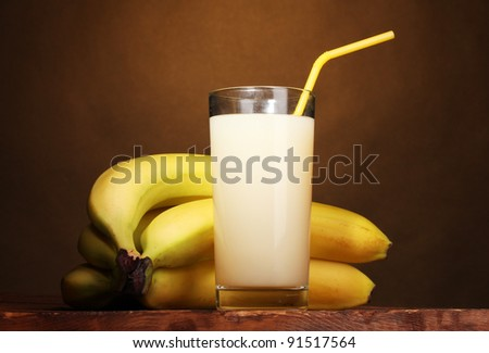 Banana juice with bananas on brown - stock photo