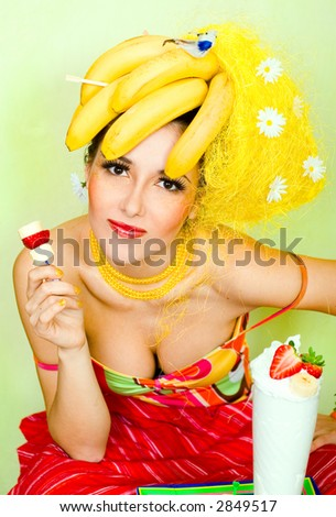 Banana lady eating a cream strawberry cocktail - stock photo
