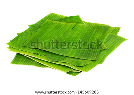 Banana leaves for wrapping or serving food as ecological dishware, isolated on white - stock photo