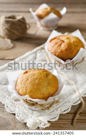Banana muffins with banana jam on wooden table - stock photo