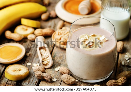banana oat peanut butter smoothies. the toning. selective focus - stock photo