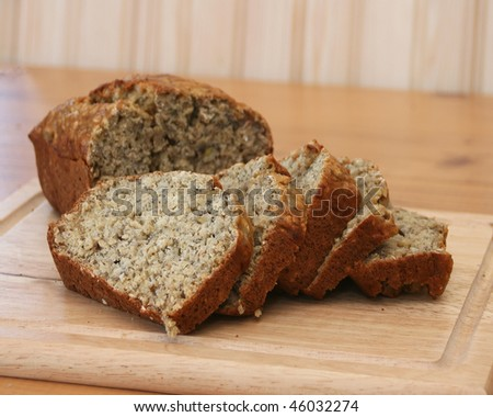 Banana oatmeal bread slices on a cutting board - stock photo