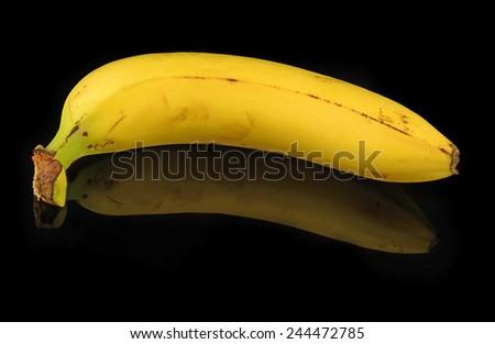 Banana on a black background - stock photo