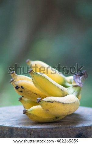 Banana on wooden chair with blurred background