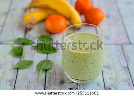 Banana Orange Spinach Smoothie for Breakfast - stock photo