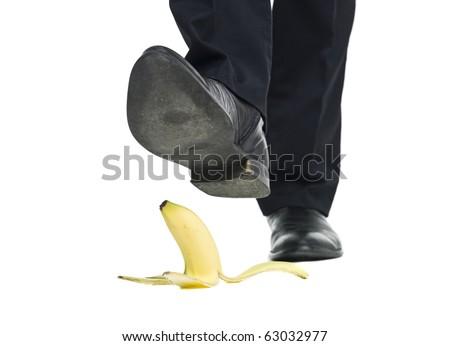 Banana peel slip isolated on white background - stock photo
