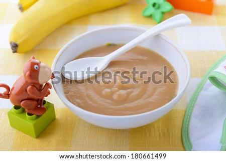 Banana puree in child`s plate - stock photo