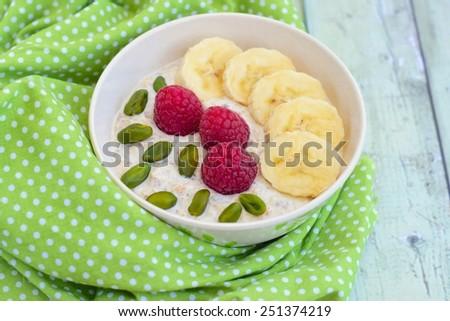 Banana Raspberry Pistachio Overnight Oatmeal - stock photo