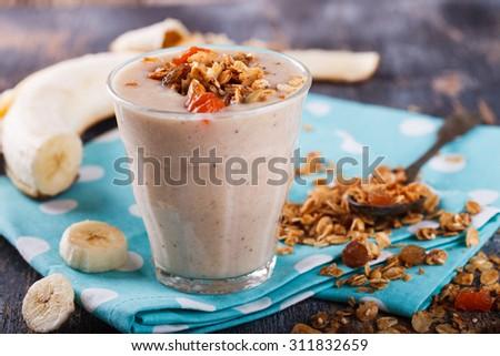 Banana smoothie homemade granola. - stock photo