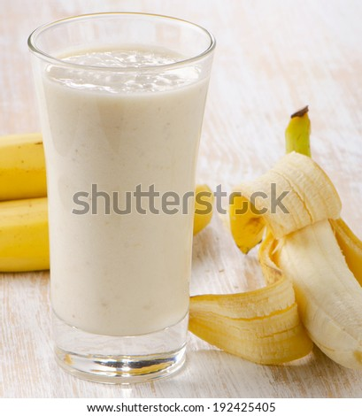 Banana Smoothie on a wooden table. Selective focus