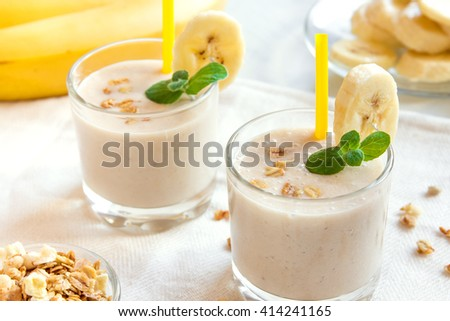Banana smoothie with oatmeal and mint for healthy breakfast - stock photo