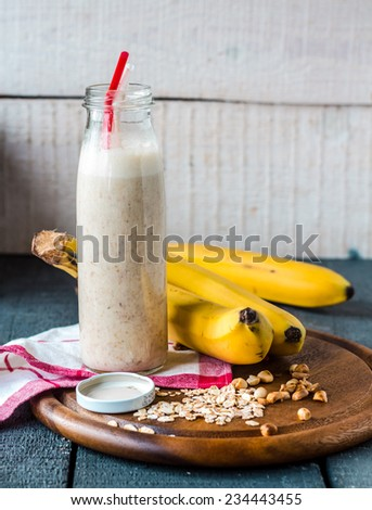 banana smoothie with walnut paste,vegetarian breakfast - stock photo