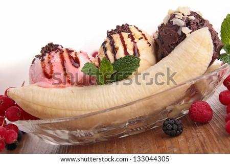 banana split and berries - stock photo