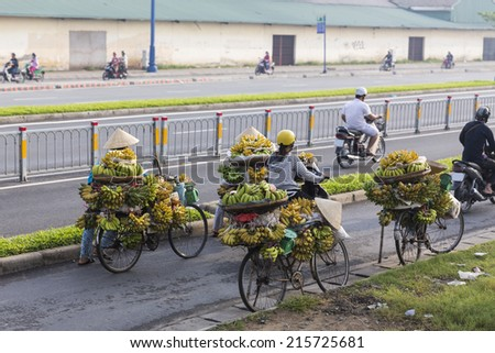 Banana street vendor woman with conical hat  at Ho Chi Minh City, Vietnam - stock photo
