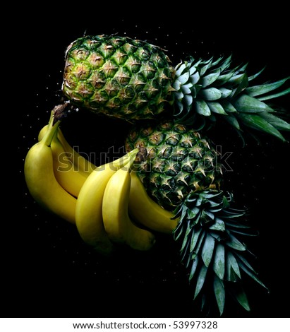 bananas and ananas on black background