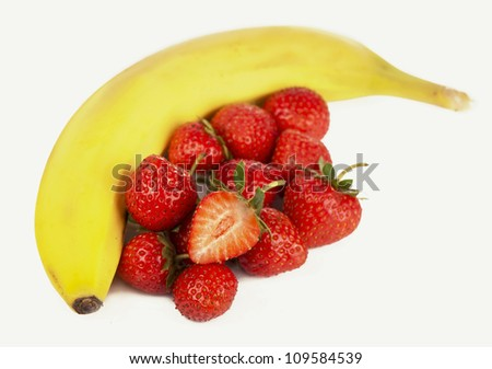 Bananas and strawberries isolated on white - stock photo