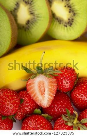 Bananas, kiwi and strawberry isolated on a white background - stock photo