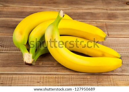 bananas on a wooden table - stock photo