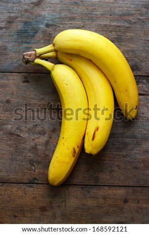 Bananas on wooden background - stock photo