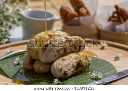 Bananas with syrup - stock photo