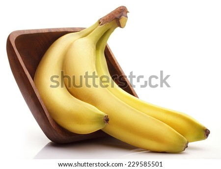 Banans in a Wooden Bowl against White Background - stock photo